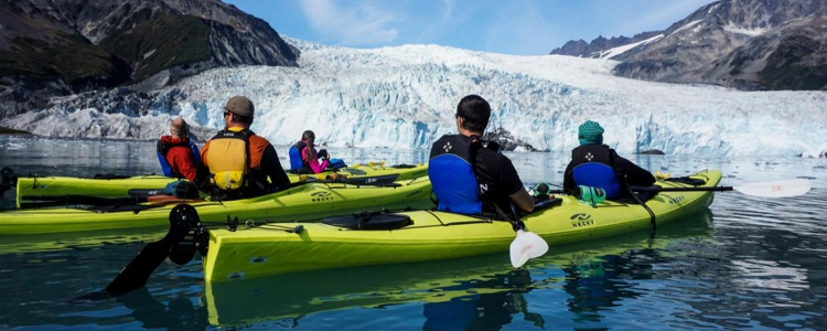 Paddlers relaxing in front of Aialik Glacier